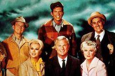 """Green Acres"" (1965-71)  Alvy Moore as Hank Kimball  Eva Gabor as Lisa Douglas  Tom Lester as Eb  Eddie Albert as Oliver Wendell Douglas  Eleanor Audley as Mother Douglas  Pat Buttram as Mr. Haney"