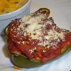 """Healthier Stuffed Peppers   """"Brown rice, lean ground beef, and fresh bell peppers make this stuffed pepper dish healthier than the original, as well as being colorful and flavorful."""""""