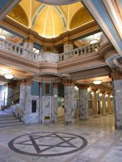 Why does the Third District Court building in Provo Utah have a Pentagram designed in the stone work of the floor????????