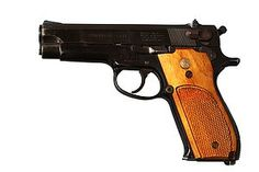 Smith & Wesson Model 39  First US designed DA semi-auto marketed in the US.    First handgun I owned.