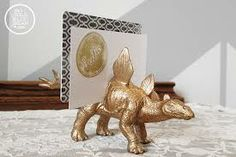 dinosaur place card holders - gold