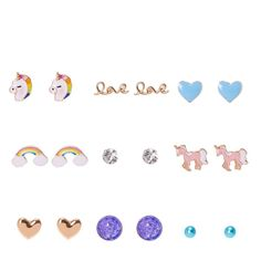 Unicorn Dream Motif Stud Earrings | Make ears look mystical with this fun set of stud earrings. These Unicorn Dream Motif Stud earrings feature a variety of designs that celebrates your love of unicorns. Includes one pair of each: blue ball, clear crystal, rainbow unicorn, light blue heart, gold love, gold heart, pink unicorn, purple druzy stone, and rainbow.
