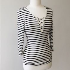 PRICE REDUCED Lace Up Front Top Never been worn! Re-posh because it doesn't fit me, size medium but runs more like a small! Very much like Brandy Melville style! Tagging: free people. Anthropologie. Urban outfitters. April Spirit Tops