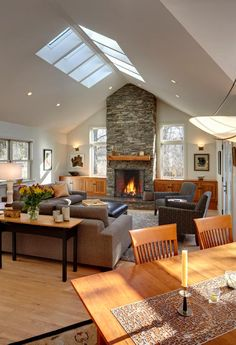 spacious. prob without skylights, vaulted ceiling, built-in cabinets next to fireplace.