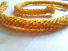 Shiny crochet collier with golden glass beads by marziafi on Etsy, $19.00