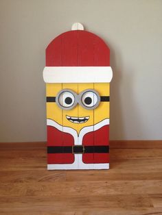 items similar to minion santa porch decoration on etsy pallet christmasminion christmaschristmas projectsoutdoor - Minion Outdoor Christmas Decorations