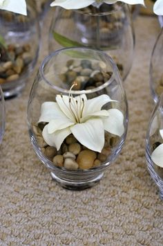 Oriental lilly with brown stones in fishbowl - cute for small center pieces