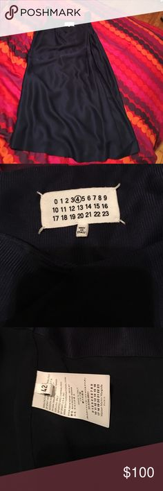 Maison Martin Magiela navy silk dress Stunning silk Margiela dress. Made in Italy. Lining is torn in two places (see photos). I've worn this once. The torn lining is not noticeable when wearing. Needs to be steamed/ironed as it got wrinkled in storage. Maison Martin Margiela Dresses
