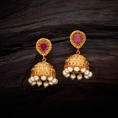 Vintage Design Antique Jhumka earrings studded with Ruby synthetic stones, with gold Polish.