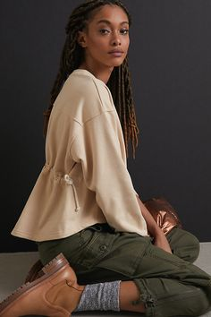 This layer features a cinched waist for a touch of feminine refinement.