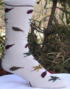 Autumn Leaves by Minnesota Custom Woolens, Inc.. $7.95. This mid-calf sock is covered with various colors of leaves which allows it to coordinate with most fall colors.  Made of 75% cotton, 20% nylon and 5% elastic.