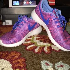 Pink and blue Nike Roshes Worn maybe 3 times. In perfect condition! I'm usually a size 6 in women but I got these in a 4.5 in kids. These are also on merc for $50 Nike Shoes Athletic Shoes