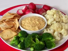 Blend chickpeas and artichoke hearts together for a nourishing Artichoke Hummus starter.