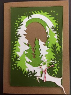 Rudolf jumping through the woods - Scrapbook.com Using Xcut Build-A-Scene Dies Forest