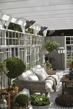 Amazing use of old windows and doors in this outdoor space.