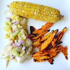 Oven baked haddock with a pineapple cucumber salsa sweet potato wedges and roasted corn with garlic butter. #cleaneating #foodie #bonappetit