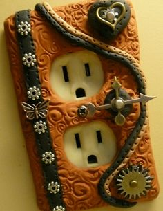Steampunk outlet covered in Polymer Clay