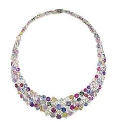 AN 18 CARAT WHITE GOLD SAPPHIRE AND DIAMOND NECKLACE Of bib design, composed of a graduated cluster panel of vari-cut sapphires in shades of pink, green, blue, yellow, orange and violet, with brilliant-cut diamond ribbon motifs and single-stone accents interspersed throughout, to a concealed clasp.