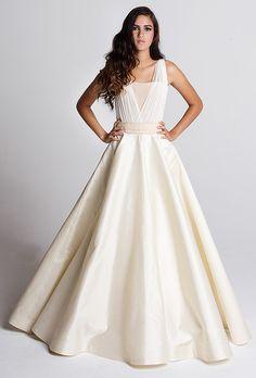 "Brides: Tara Latour - Fall 2014. ""Etta"" 4-ply crepe and silk tulle mesh top, French Alencon lace detailing, ""Edaline"" silk zibeline ball gown skirt with pockets, Tara Latour"