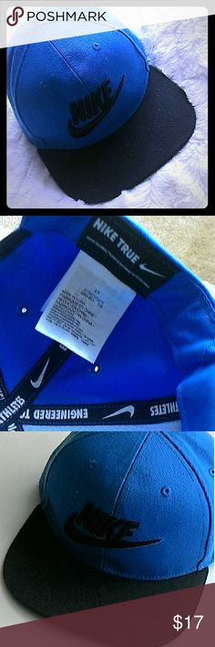 NWOT Nike Cap! Cutest cap ever. I bought it last year, but never wore it. SIze 4/7 with a snap back for adjusting fit. Says Nike in script on the front with their logo.   It's hard to get a good pic of it. Pristine and never worn. Really pretty shade of blue with a black bill. Just do it! Nike Accessories Hats