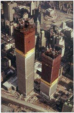 aerial view of twin towers of the world trade center under construction looking east, february, 1971 (by eralsoto)