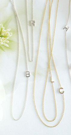 { Asymmetrical letter necklaces }