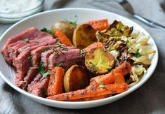 TESTED & PERFECTED RECIPE - This corned beef and cabbage is roasted in the oven and served with roasted veggies tossed in a flavorful horseradish-butter. Slow Cooker Corned Beef, Corned Beef Brisket, Slow Roasted Corned Beef, Roast Beef, Roasted Cabbage, Corn Beef And Cabbage, Cooked Cabbage, Beef Recipes, Cooking Recipes