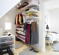 Attic Closet Ideas - Walk-in attic room storage room features a sloped ceiling lined with rustic timber beams over tilted integrated in footwear cubbies and also sweater shelves alongside a window seat. Ikea Algot, Attic Bedrooms, Closet Bedroom, Bedroom Storage, Home Bedroom, Attic Closet, Bedroom Ideas, Master Bedroom, Attic Office