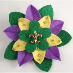 Mardi Gras Felt Flower Pin with Gold Fleur de Lys Button and Beads... ($20) ❤ liked on Polyvore featuring jewelry, brooches, fleur de lis jewelry, beading jewelry, fleur de lis brooch, button brooch and beaded jewelry