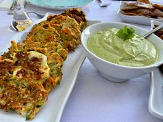 In case you are wondering what Mucver is, it is a Middle Eastern favorite made with grated zucchini, carrots, onion, feta cheese, and spices then fried into a delicious flavorful fritter that is equally good hot as it is cold then next day.  And the Tahini Sauce is a fabulous tangy dip that I devour with these fritters as well as some lightly toasted pita bread.  I mean, YUM-O Lamb Kebabs, Hot Appetizers, Zucchini Fritters, Tahini Sauce, Pita Bread, Coriander, Feta, Onion