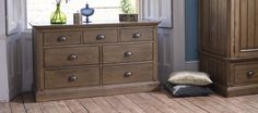 A wide, ample dresser featuring Manor Houses unique style traits including decorative dowels, flat-fronted drawers, metal cup handles, and a darker vintage finish. This dresser is perfect in any room you need stylish storage, whether bedroom, hallway, landing, or living room.