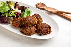 Quinoa and Vegetable Burgers With Asian Flavors Recipe Main Dishes with cooked quinoa, canola oil, fresh shiitake mushrooms, fresh ginger, garlic cloves, red bell pepper, chopped cilantro, arugula, salt, white beans, fresh lime juice, eggs, soy sauce, freshly ground pepper