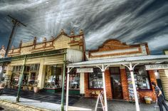 Historic Maldon. The town of Maldon is located in an historical gold mining region between the larger centres of Castlemaine and Bendigo known as the Central Victorian Goldfields in Victoria, Australia. Maldon has been perfectly preserved since the mining days dating from the 1850s and is Australia's first 'Notable Town' as classified by the National Trust in 1966. The buildings depicted here in Main Street are from those earlier times although their purposes may have changed.