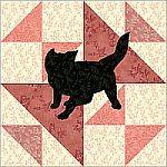 Old Maid's Puzzle quilt block with cat applique