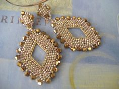 Old Rose Gold Goddess earrings created with beautiful shades of gold, rose and bronze metallic 11/0 seed beads and over fifty bronzel genuine crystal