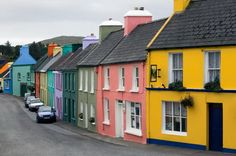 Row houses painted in a spectrum of colors. These are in Ireland, County Cork, Beara Peninsula, Eyeries Village.