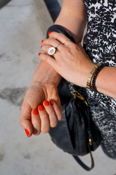 Daisy ring from Georg Jensen, other gold rings from Moss Copenhagen, Essie 'E-nuf is E-nuf' nail polish, gold bracelet from Coordinates Collection and black bracelet from Black Colour