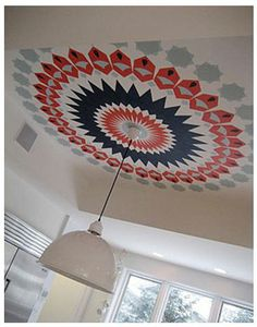 Fun ceiling splash to accent hanging lighting--would be so cool, but perhaps a bit much for over our dining table...