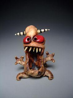 Kinda creepy but kinda cute too. LOL    Little Ceramic Monster by monsterme on Etsy, $25.00