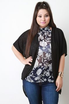 This plus size cardigan features a knit fabric, pleated shoulder detail, short dolman sleeves, and open front construction. Finished with a high-low hemline. Accessories sold separately. Made in U.S.A. 79% Polyester, 21% Rayon.