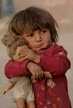 Gaza's Palestinian child covering eyes of her doll