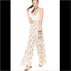 Brandy Melville Aarika floral pants high waisted These pants are in excellent condition. Worn once. 100% rayon. One size. Fits a XS-S best. Sold out everywhere Brandy Melville Pants Wide Leg