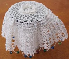 Hand Crocheted Vintage Milk Jug Cover 24cms Diameter Crocheted in White Cotton with raised rossette in center and weighted with colourful beads. Never Used so in excellent condition.