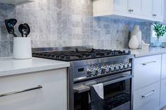 Property Brothers took regular 3 x 6 subway tiles and installed them in an unconventional way to create this unique kitchen backsplash! Love it!