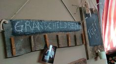 Chalkboard on heavy piece of barnwood with clothes pins to hold whatever you want.