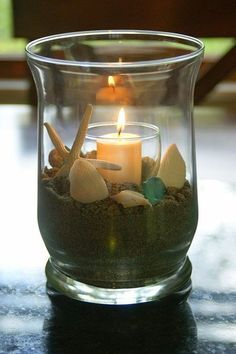 Nice, simply, and inexpensive beach theme centerpieces. maybe the dollar tree would have shells and rocks and globes and candles Beach Crafts, Diy And Crafts, Beach Theme Centerpieces, Centrepieces, Centerpiece Ideas, Deco Marine, Candle Jars, Candles, Candleholders