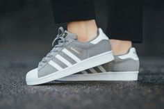 Grey suede and white adidas sneakers