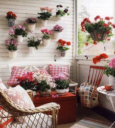 I like the way these flowers use the wall to add interest to the space. It's a little too feminine for my family's balcony but a great idea. Now - how to mount the baskets? I have similar slats...