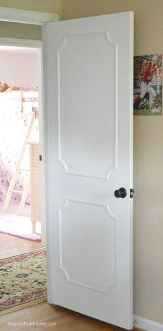 Adding trim to a plain door to dress it up Paneled Door www.thepainteddrawer.com