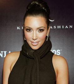 Kim Kardashian in 2009 - Kim Kardashian Top Knot - Kim Kardashian Tight Braided Bun - sleeveless turtleneck sweater - Kim Kardashian Beauty Then and Now